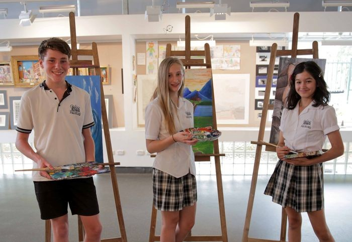 students painting with easels