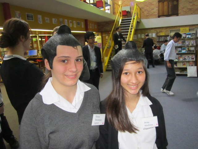 Two of our students wearing Japanese head wear.