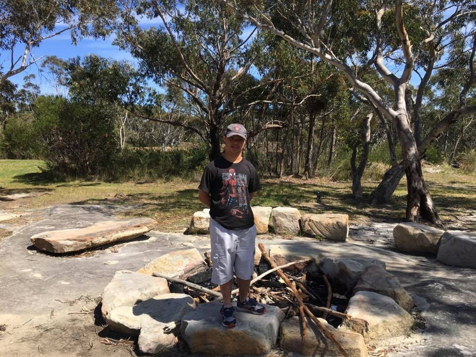 One of our students at the campfire pit.